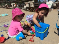 Digging in the sand with her best bud, Khloe.